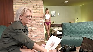 Sexy GILF photographer having sex with a luring young woman