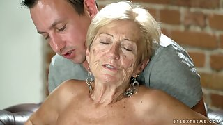 Filthy granny Malya has an affair with young coxcomb living nextdoor