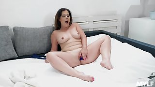 MILF rubs pussy able-bodied toy fucks the tiny hole nearby good-looking XXX scenes